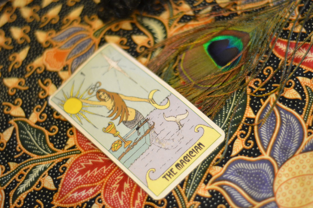 Peacock feather and tarot card